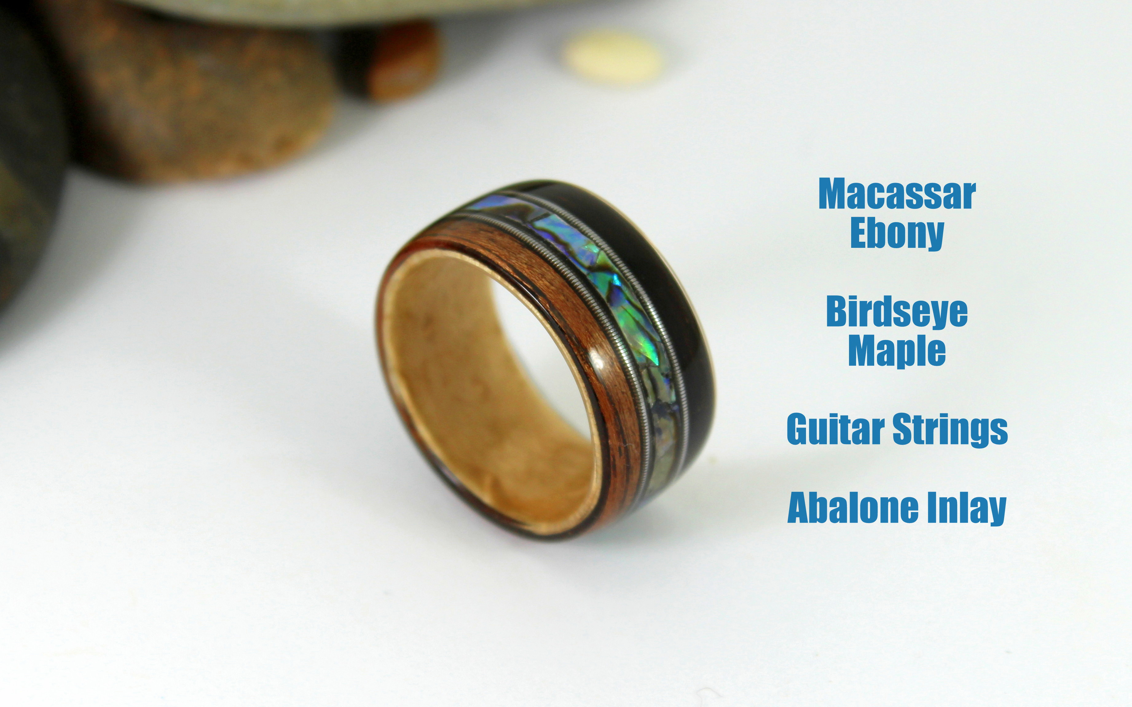 Picture of Bent Wood Ring With Guitar Strings and Abalone Inlays