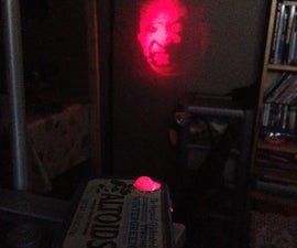 Clandestine motion activated ghost projector (AKA the BOO box)