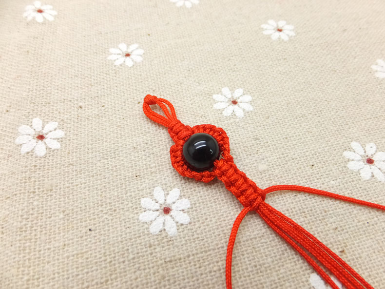 Picture of Pull the Longest Cords, and Continue Braiding Bracelet by Using the Square Knot.