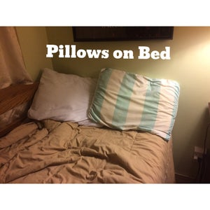 Put Pillows on Bed.