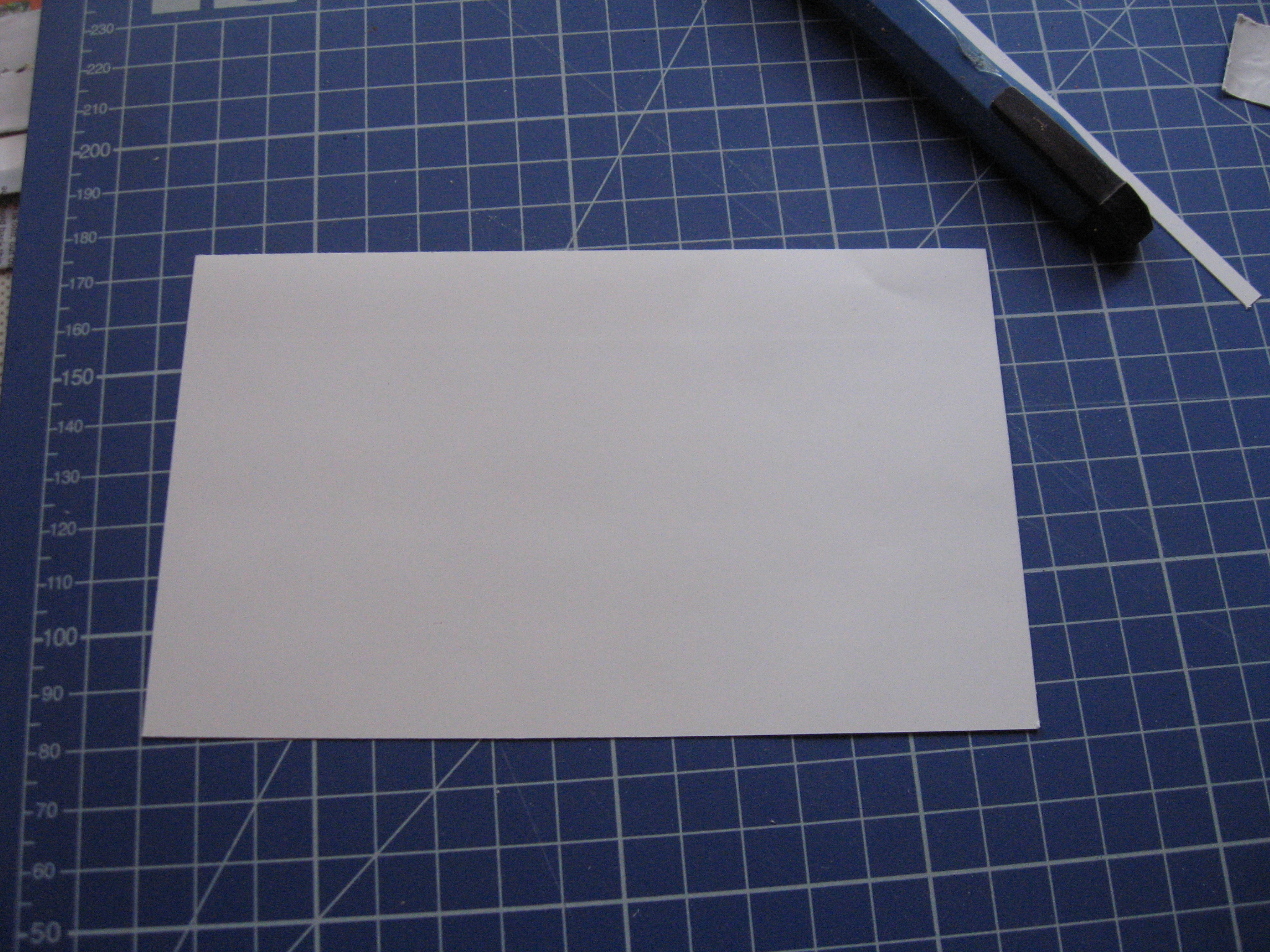 Picture of Glue a Card Stock Paper at Bottom