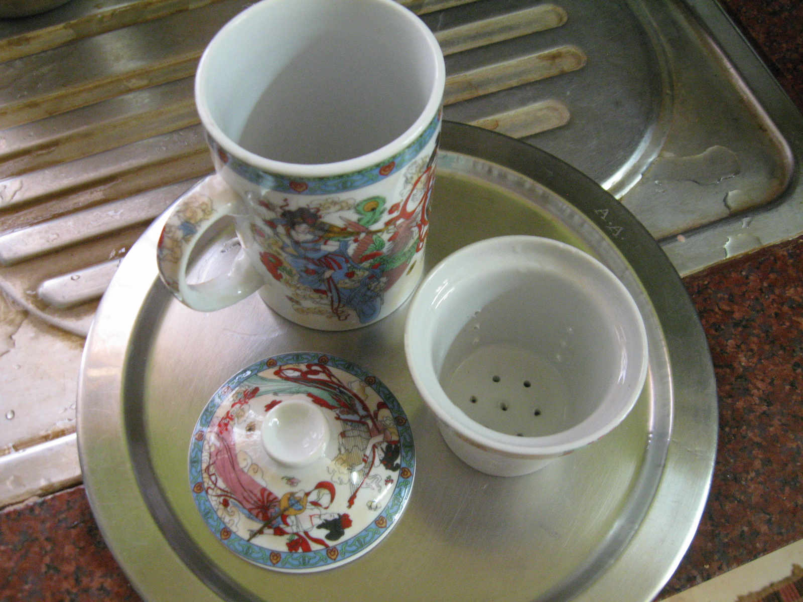 Picture of Green Tea Leaves and Tea Pot for Making Green Tea