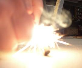 Using Swedish FireSteel to ignite tinder