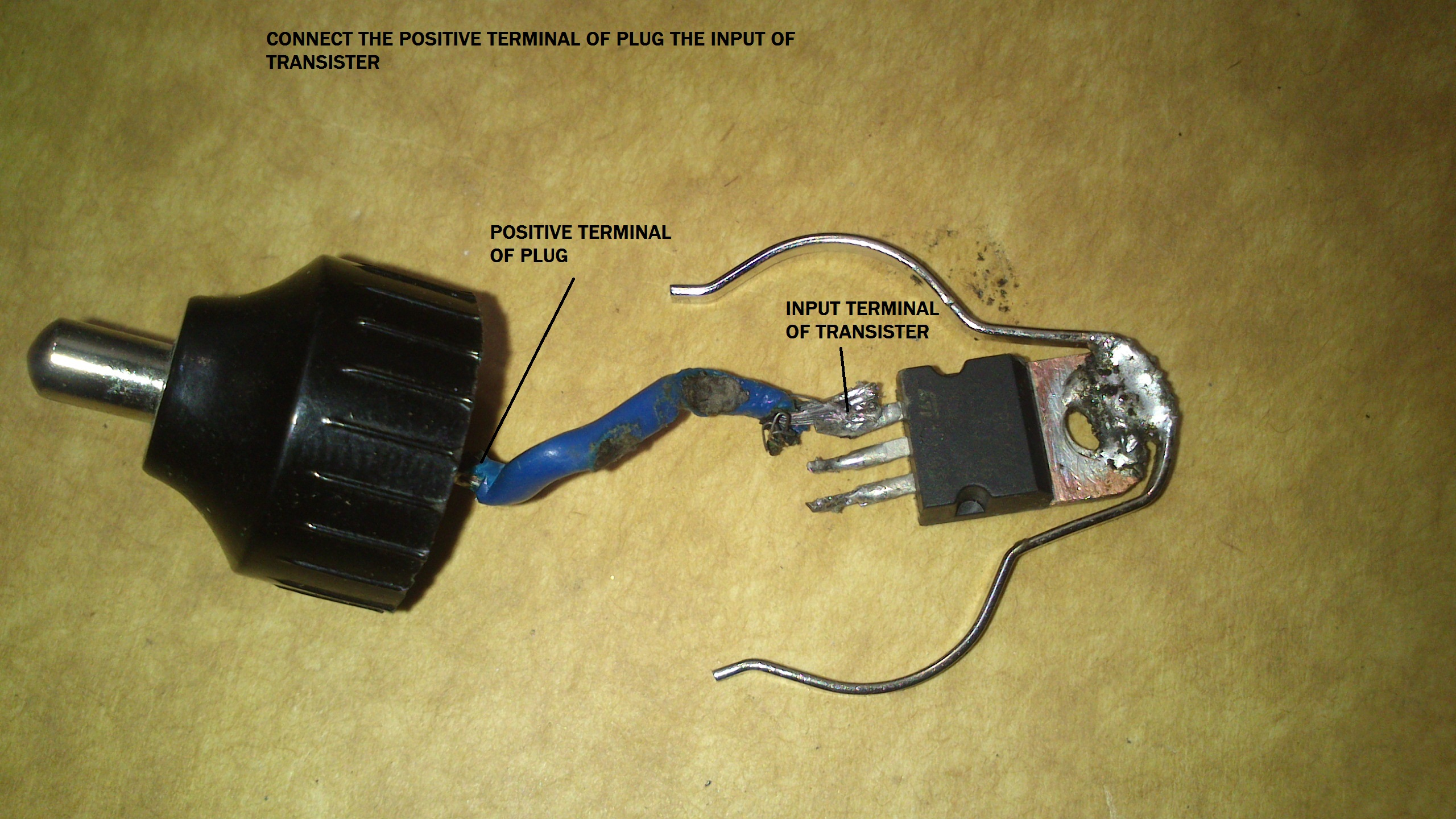 Picture of CONNECT POSTIVE TERMINALS OF PLUG WITH INPUT OF TRAQNSISTER