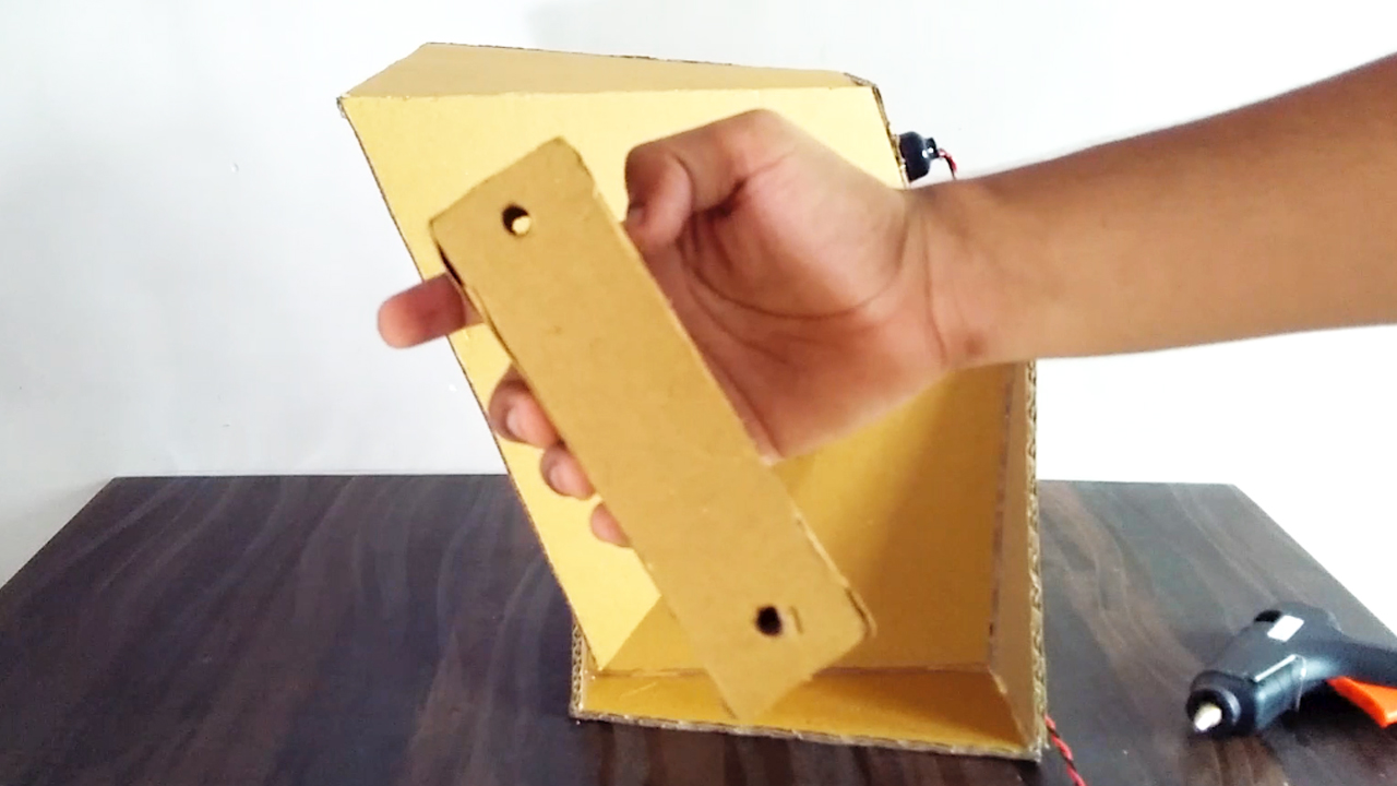 Picture of Make Cardboard Block for Providing Height and Angle to Direction of Softbox Light ( Refer Video )