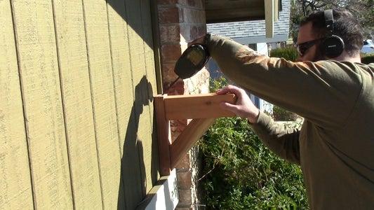 Attach the Corbels Above the Garage Door.