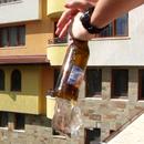 Crack the bottom of the beer bottle