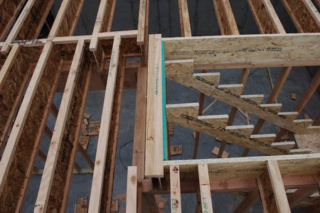 Stairway and Balcony Openings Are Framed Using Bearing Walls or Beams Below