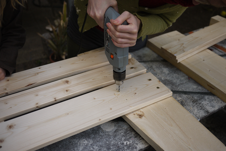 Put the Sides Together: Screw the Side Slats Onto the Legs.
