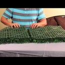 Applying Artificial Hedge Mat to a Wooden Fence