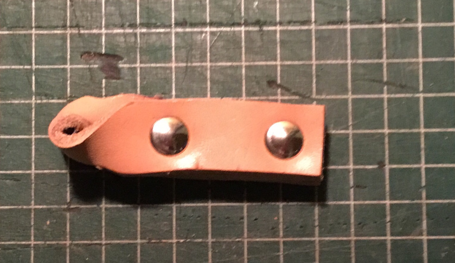 Picture of Glueing the Leather and Setting the Rivets.