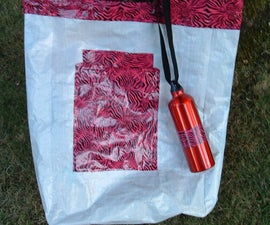 Make this durable storage bag, or beach bag from an empty dog food sack.