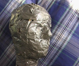 Making a Stunt Dummy Head Out of Cardboard, Duct Tape, and Newspaper (Part one)