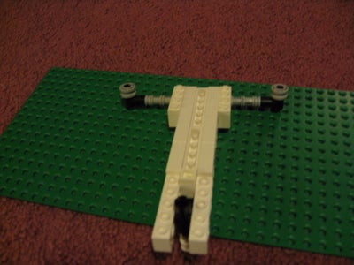 Put the Same Pieces on the Other Side of the Axle.