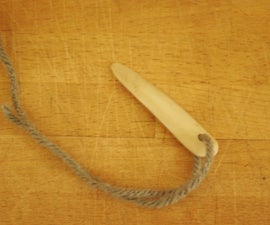 Carve a bone needle for naalbinding