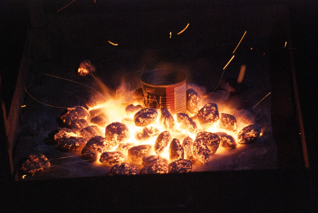 Picture of Boil Grease in a Can Over a Hot Fire