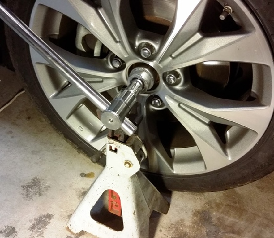 Picture of Loosen the Axle Nut and Jack Up the Car