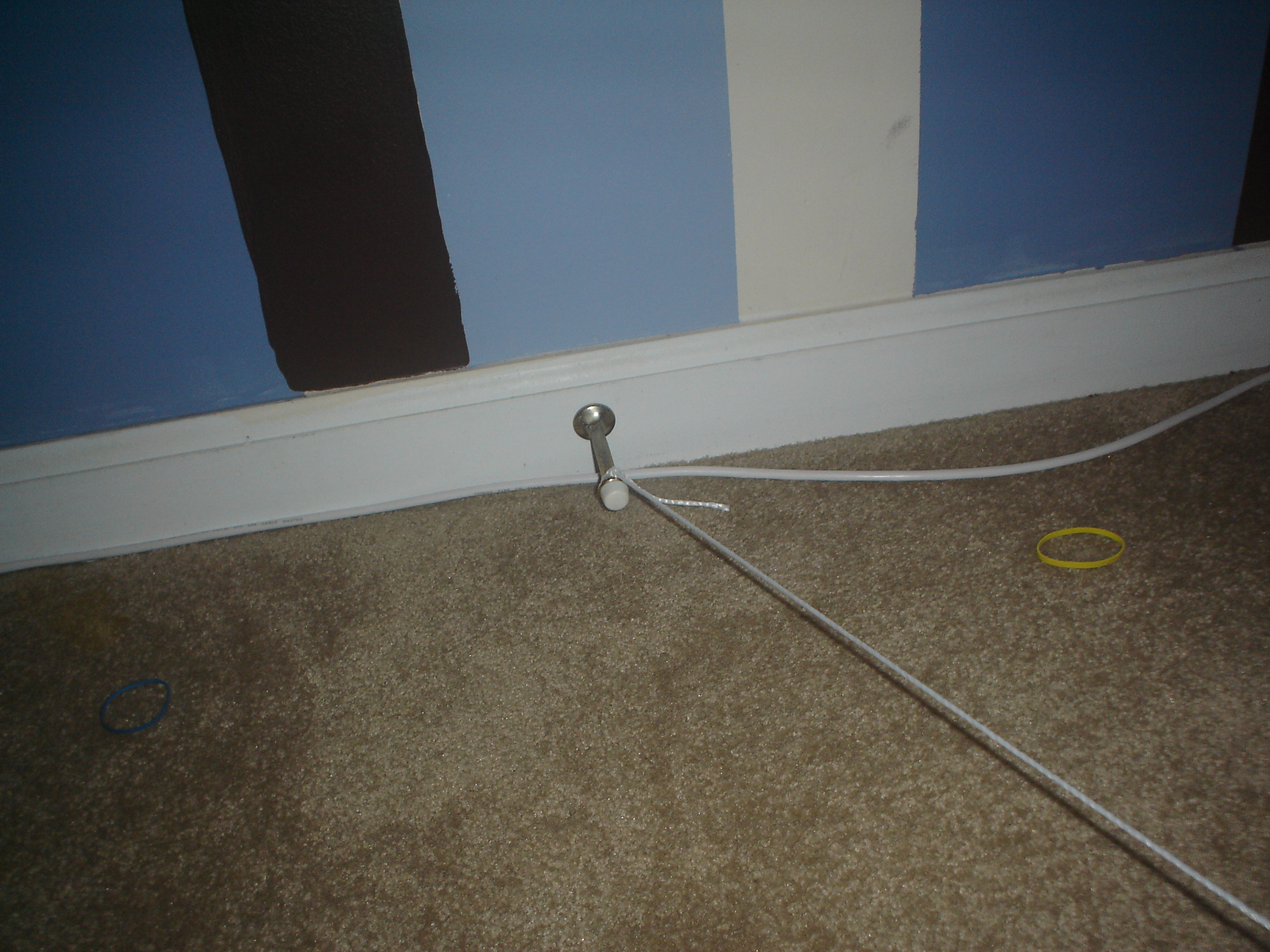 Picture of Tie to a Doorstop or Some Nail Sticking Out of a Wall or Something