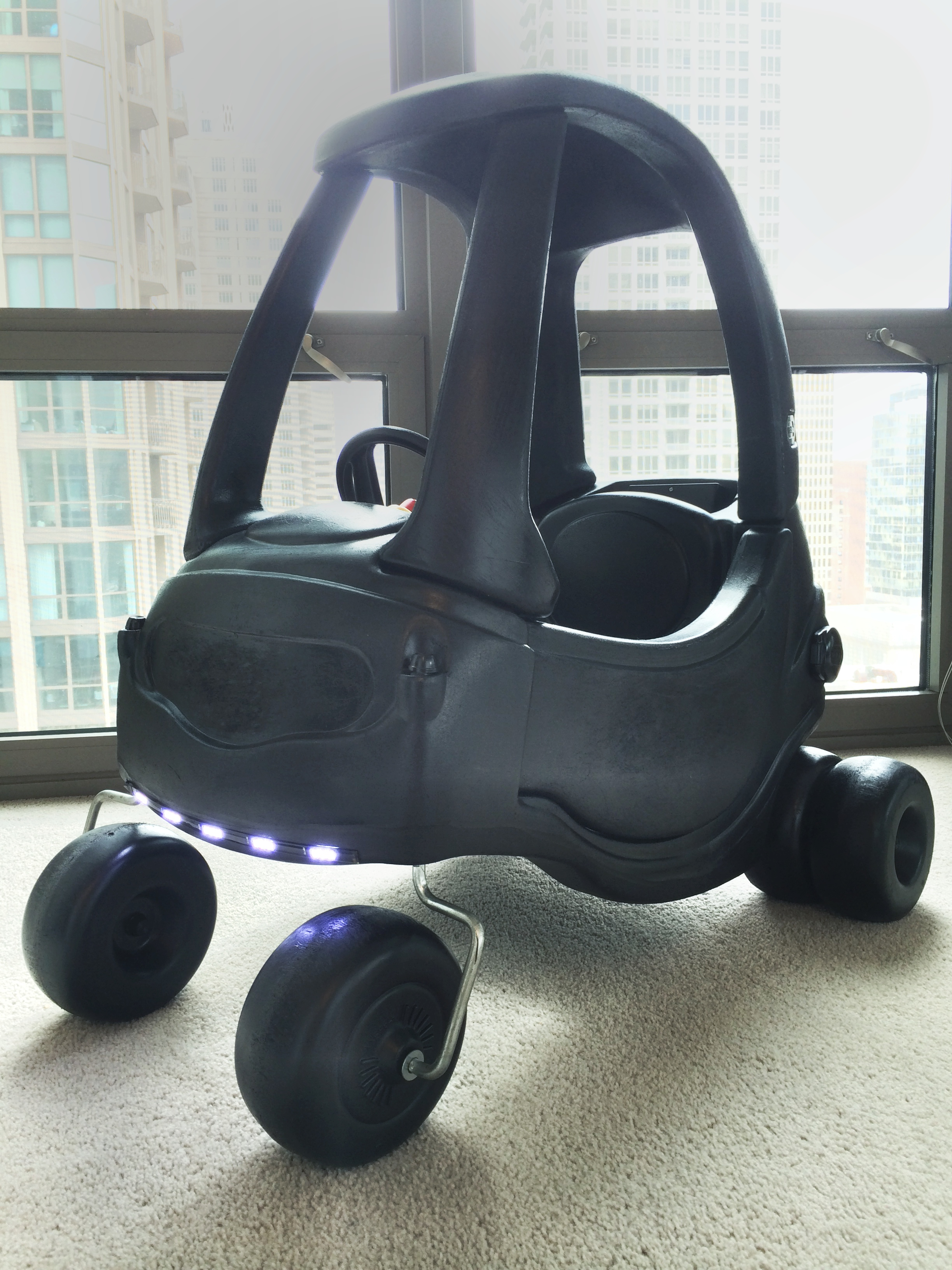 Picture of Tiny Tikes Tumbler Batmobile Out of a Cozy Coupe