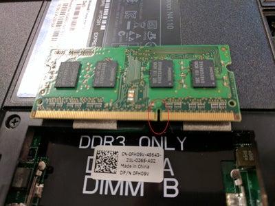 Insert New RAM Into Bottom Slot First