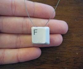 xkcdian SkiFree 'F' key pendant