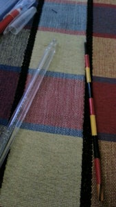 3.For the Pen,tape the Refill of Pen According to Flag Color One by One.