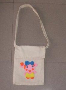 Glue Miss La Sen Felt Doll Onto the Sling Bag.