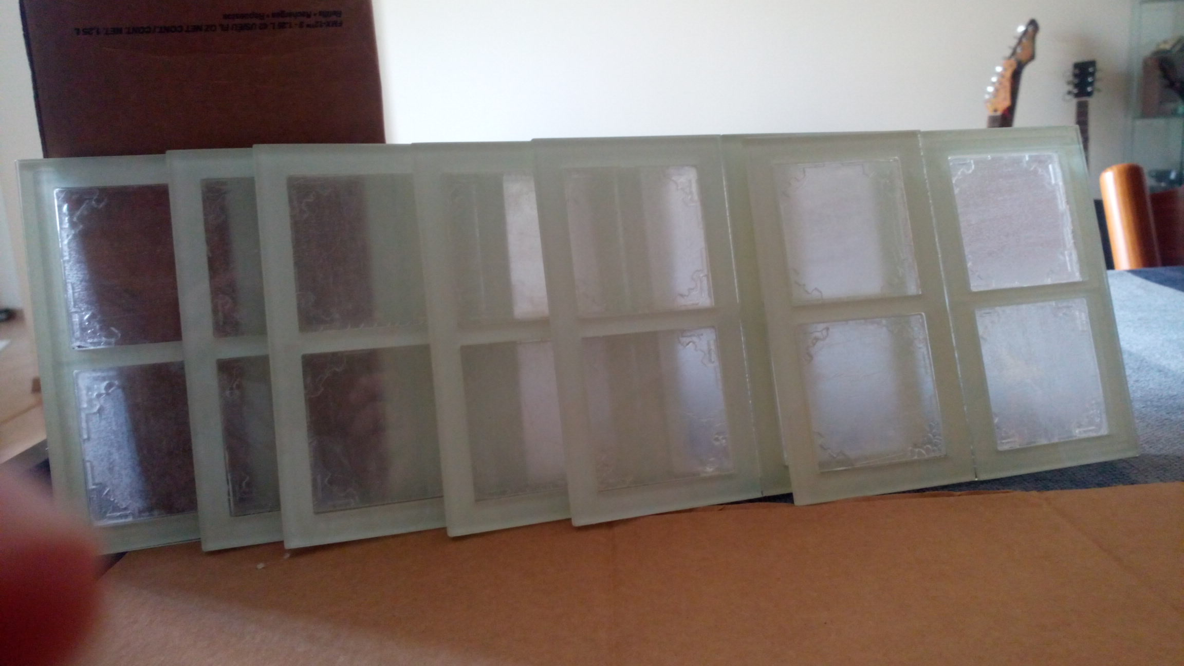Picture of Gluing the Acrylic White Squares on the Frames