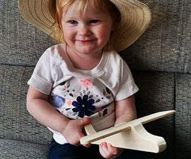 Build a toy airplane using only hand tools.