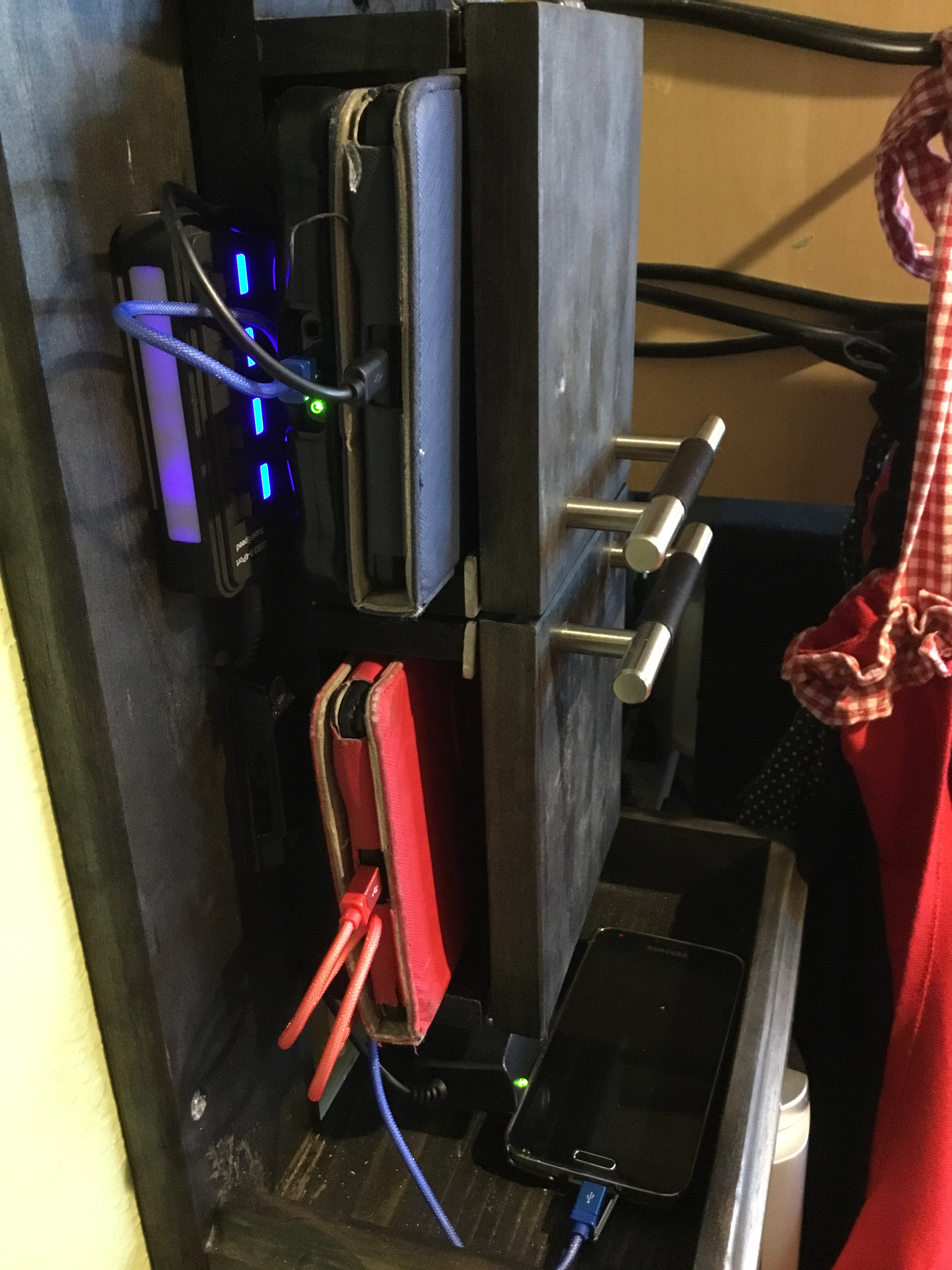 Picture of Charging Slots. Top to Bottom.
