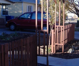 My lovely $100 pallet wood picket fence!