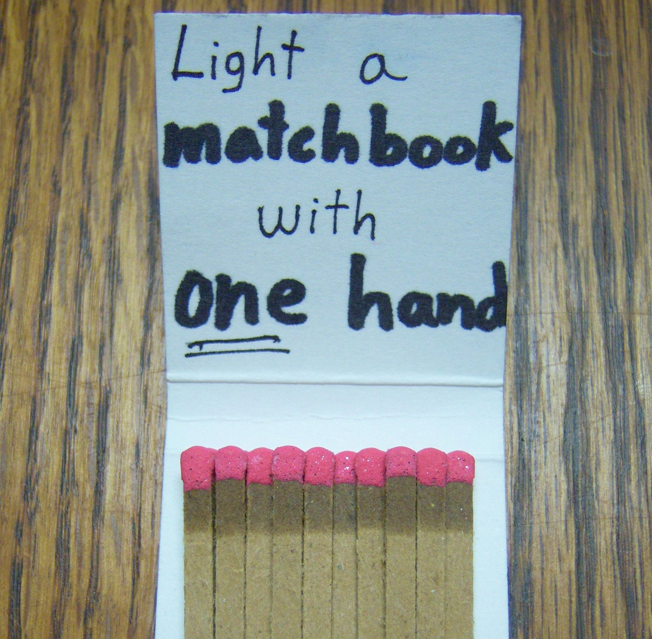 How to Light a Matchbook With One Hand