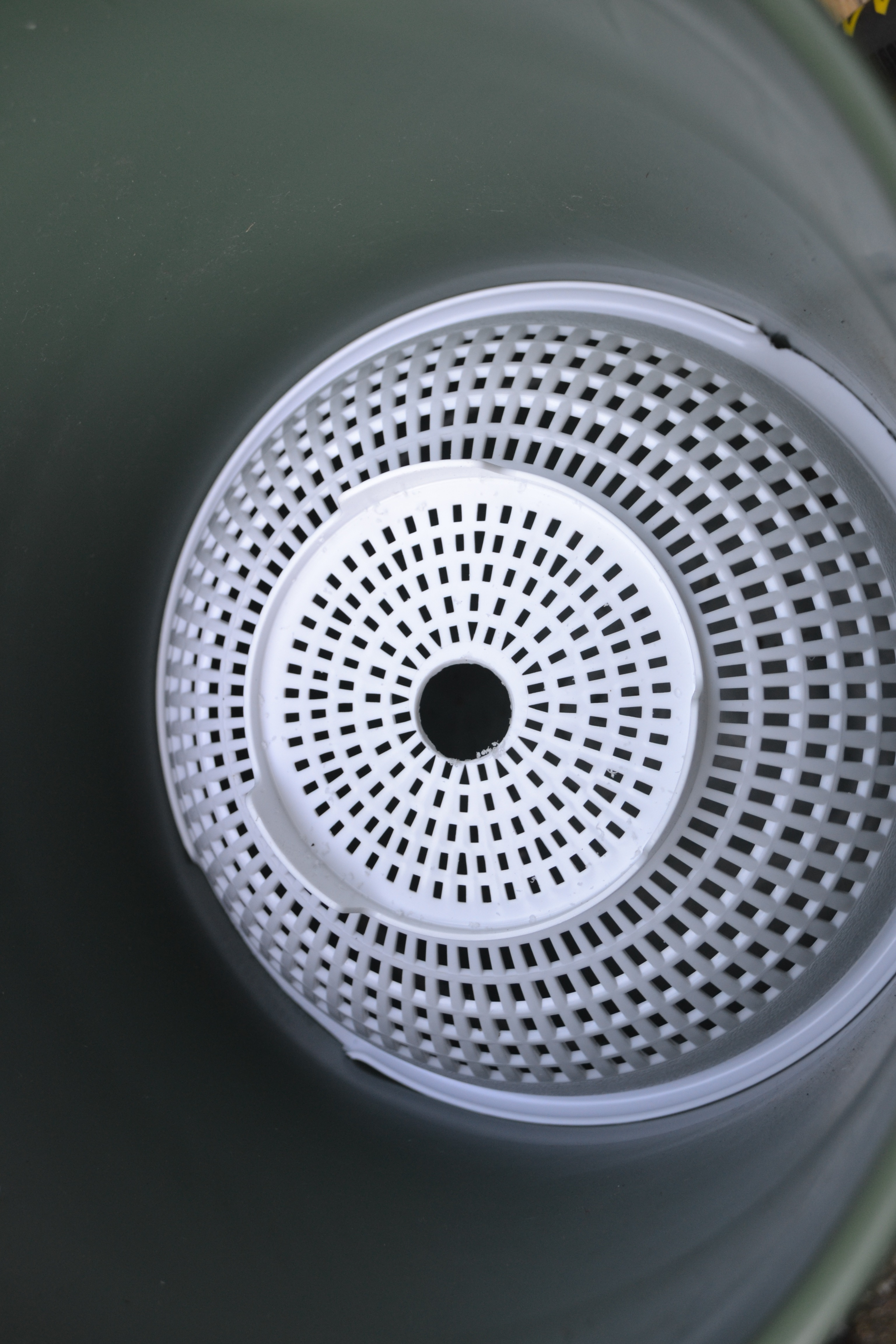 Picture of Fit the Colander Into the Bucket; Fit the Pipe Into the Colander