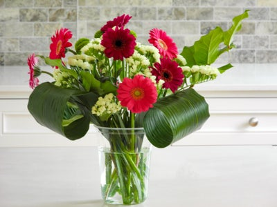 Trim Stems and Arrange Flowers in Plastic Tub