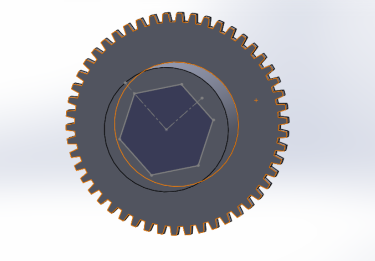 Picture of Create Two Centerlines Along the X and Y Axis on the Front Face, and Use Mirror Entities to Sketch a Right Hexagon at the Top of the Gear