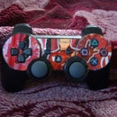 PS3 controller decorated with an Iron Man Dr.Pepper can.