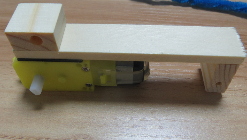 Picture of Make the Motor Adhere to the Wooden Frame