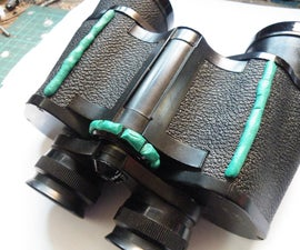 Binocular modification for poor grip.