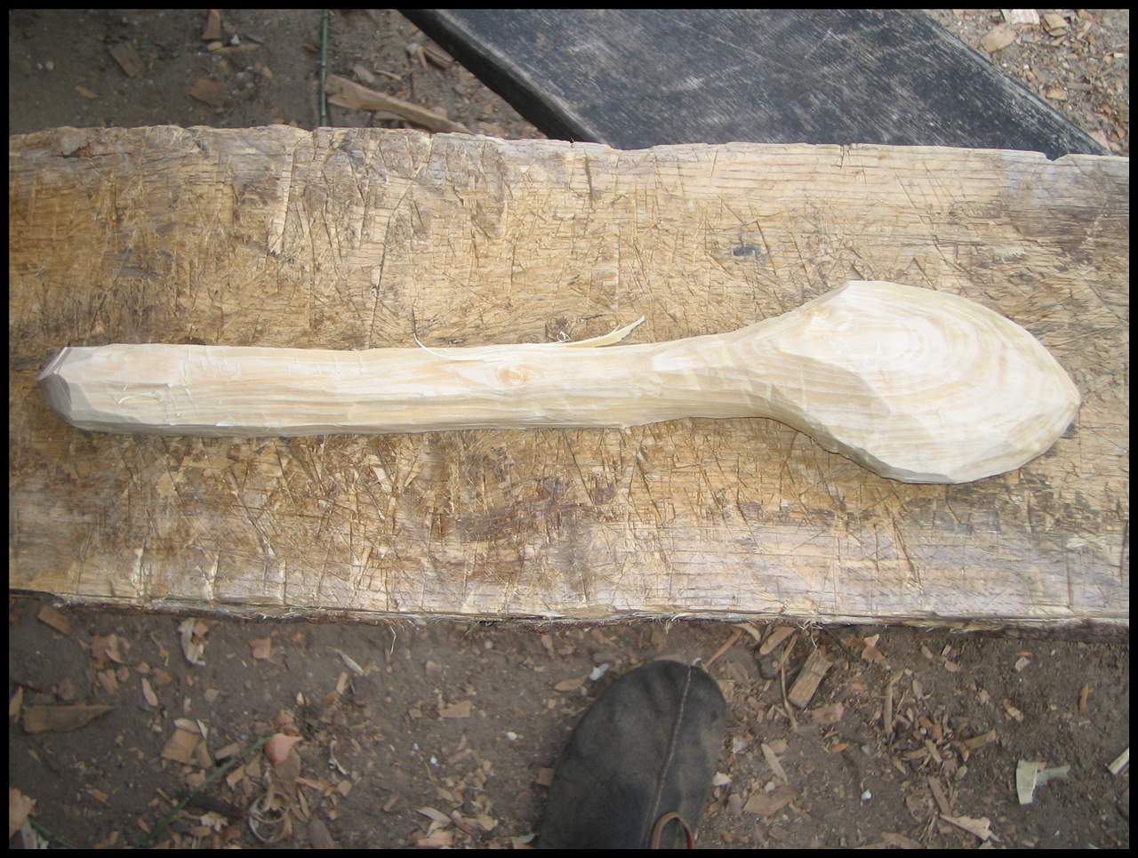 Picture of Cut the Rougt Shape of the Spoon With the Axe.