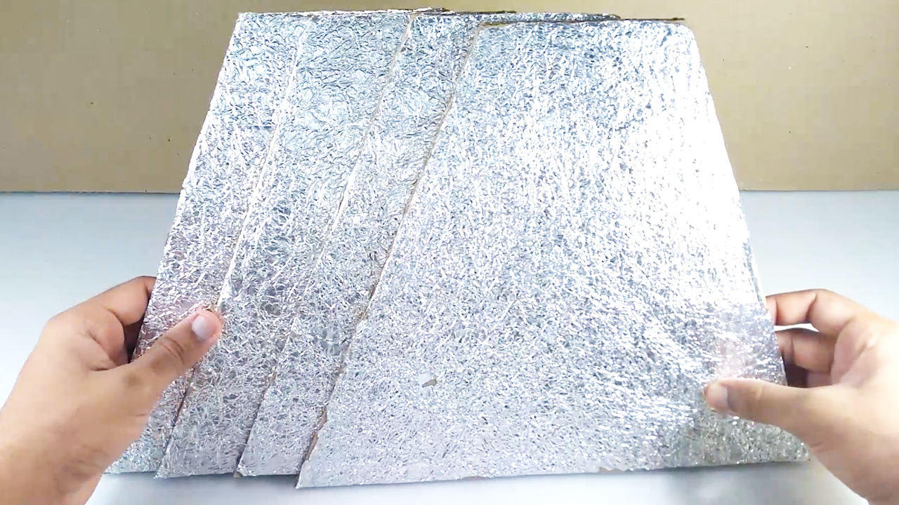 Picture of Stick Sheet of Aluminium Foil on One Size of All the 4 Cardboard Sheets ( Refer Video )