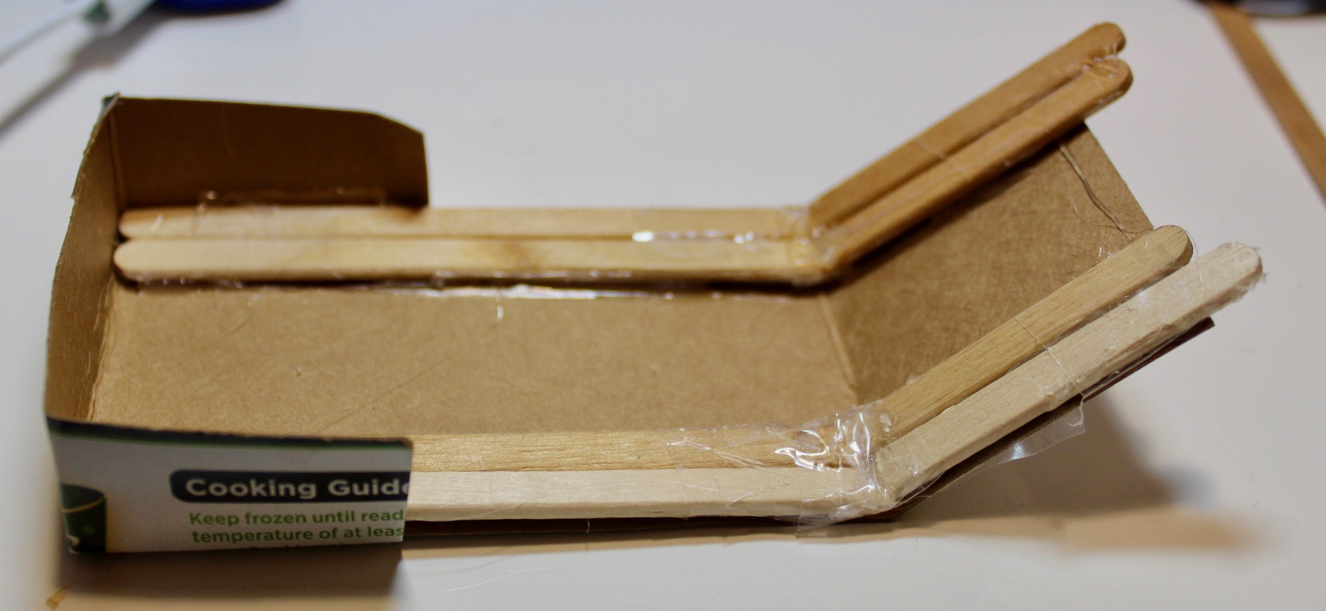 Picture of Glueing the Cardboard to the Bottom Claw
