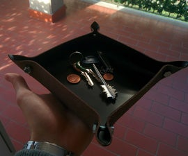 Leather tray with bolts
