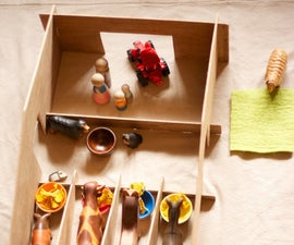 Make a Barn for Toy Animals from a piece of recycled plywood  (or cardboard boxes)