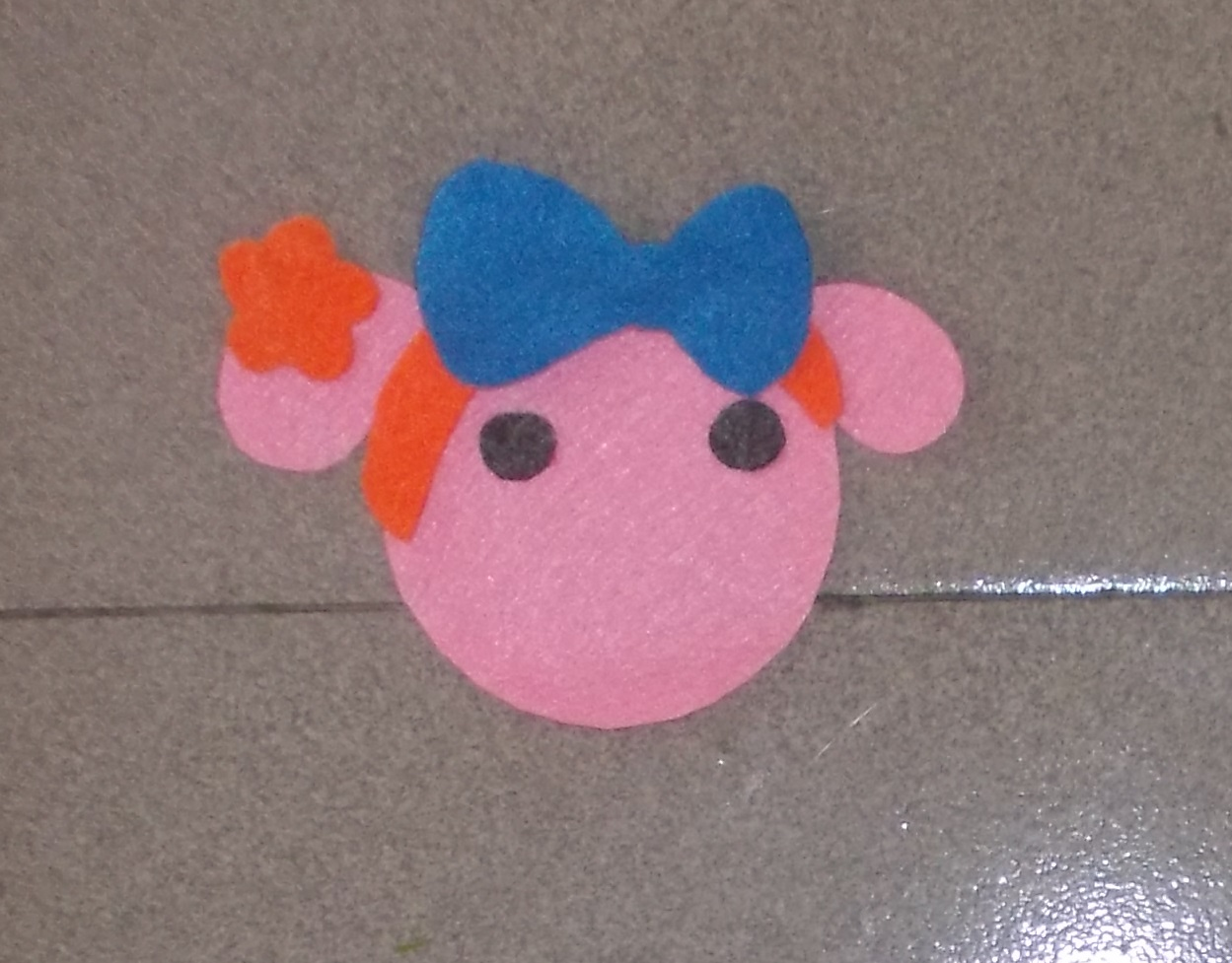 Picture of Cut the Blue Felt Bow,  Felt Eyes and Glue Them Like This Picture.