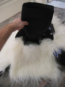 Pull Shoulder Pads Through the Big Piece of Fur