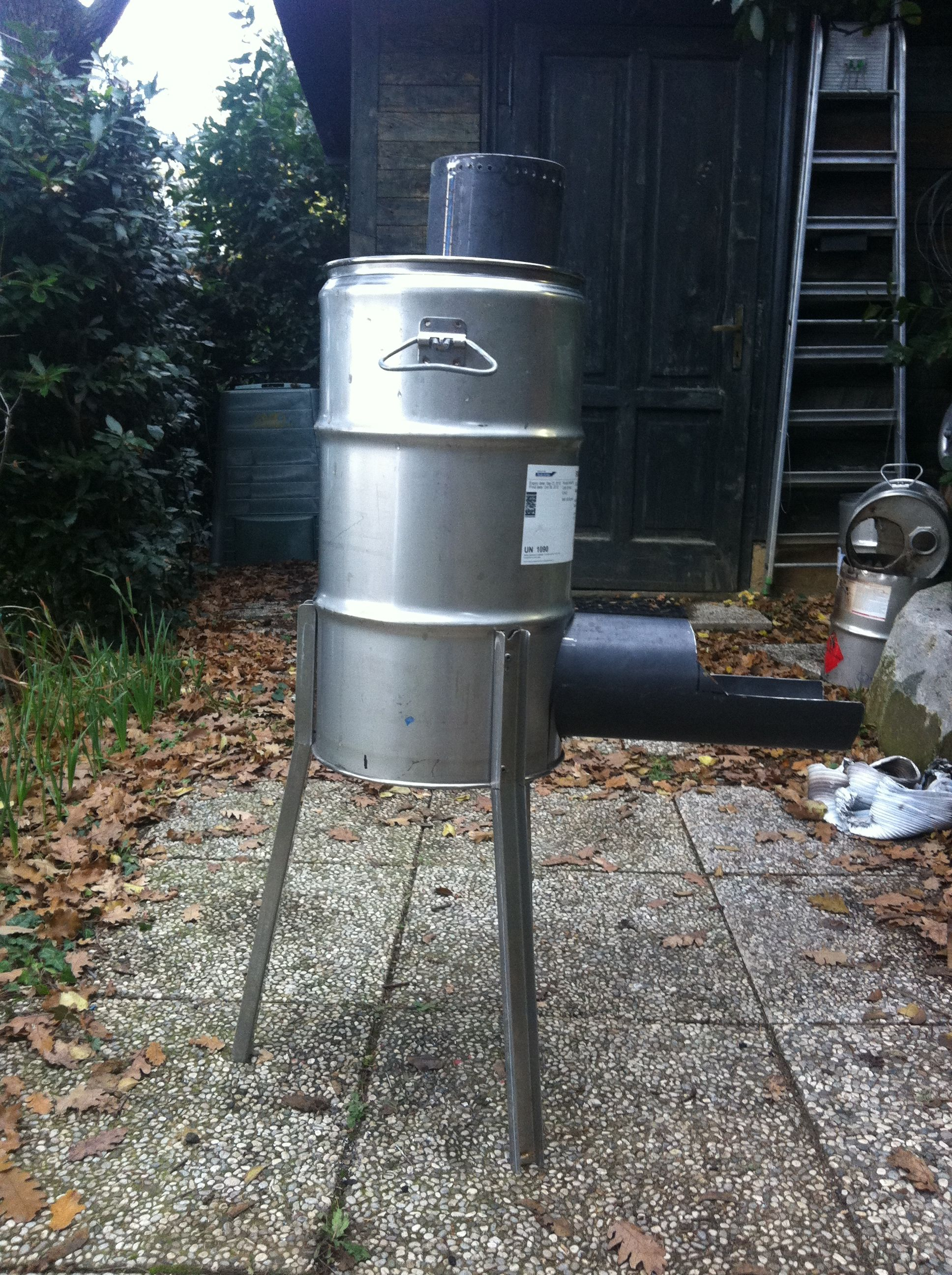 """Picture of The Idea """"making a Rocket Stove Simple Cheap Convertible in a BBQ"""""""