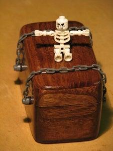 Piecax the Poltergeist.  a Troublesome Spirit in a Box.