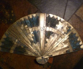 Folding brass fan with etched designs