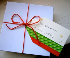 Recycle Christmas cards into gift tags!