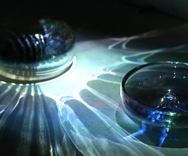 One to Hold, One to Echo: a performance in glass, video, and music